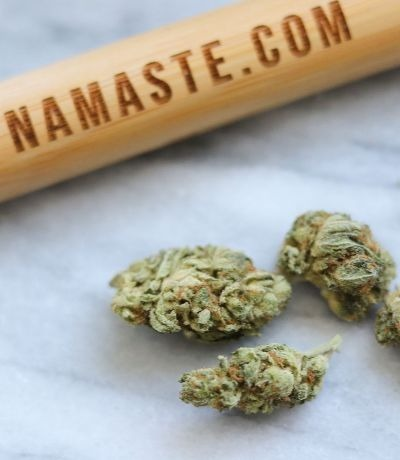 Namaste Ultra Sour - High-THC Sativa Dominant Hybrid Cannabis Strain - Dried Bud on Table